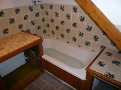 baignoire acrylique neuve sous toit